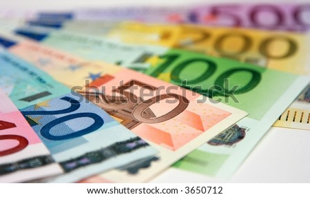 Euro banknotes, close-up with shallow depth-of-field; focus on the 50 Euro banknote - stock photo