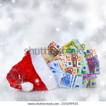 Euro banknotes coming out of Santa Claus hat - stock photo
