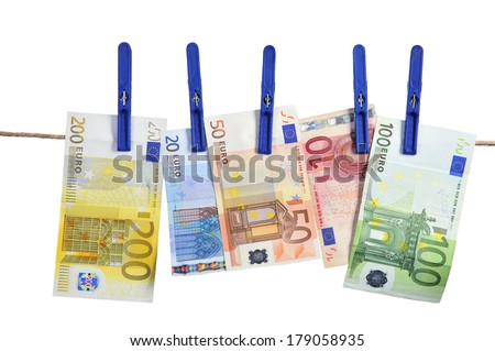 Euro banknotes hanging on laundry line attached with plastic clothespins against white background - stock photo