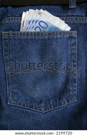 euro banknotes in a jeans pocket