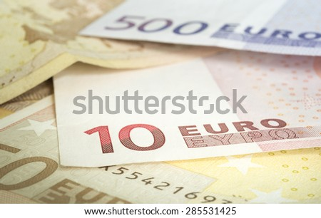 euro banknotes in a row stacked by value; European Union Currency. Selective focus.