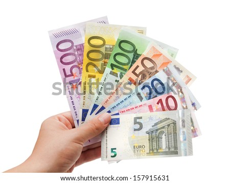 euro banknotes in hand on white?