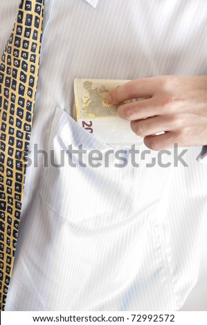 Euro banknotes in shirt pocket