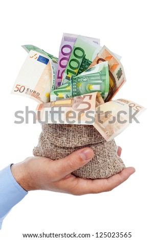 Euro banknotes in small burlap sack held in businessman hand - stock photo
