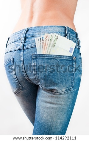 Euro banknotes in the back pocket of jeans - stock photo
