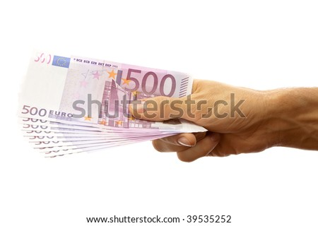 Euro banknotes in the men's hand. Isolated on white. - stock photo