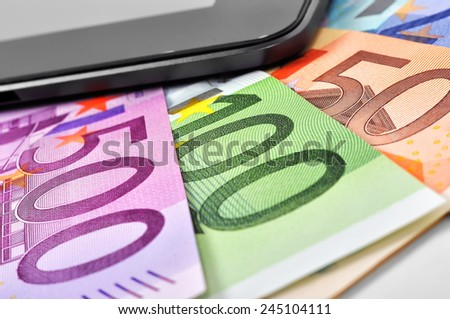 euro banknotes of the european union and cellphone