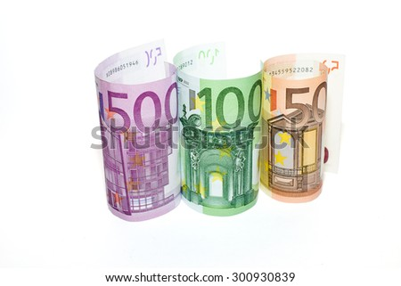 EURO-banknotes  of various denominations on a white background