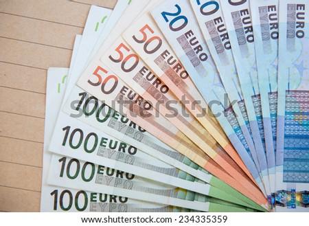 euro banknotes on brown envelope - stock photo