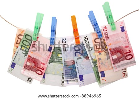 euro banknotes on clothesline - stock photo