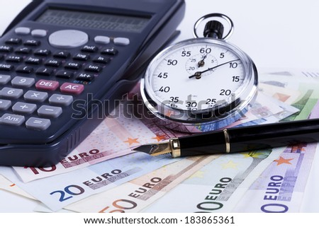 Euro banknotes on white background with black calculator and silver analog stopwatch - stock photo