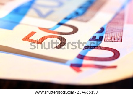 Euro banknotes on wooden table, macro view - stock photo