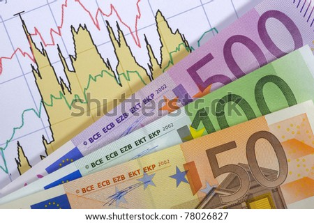 euro banknotes over business finance chart - stock photo