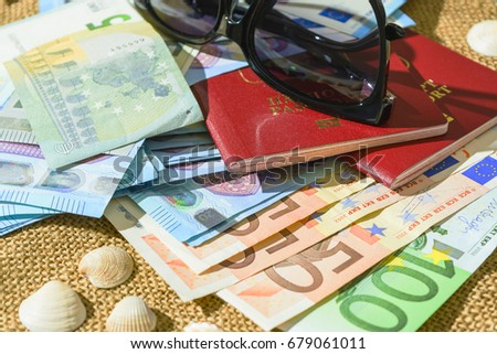 Euro banknotes, passports and shells on a linen background. the concept of travel