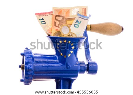 Euro banknotes while destruction in mincer as symbol for inflation or financial mismanagement