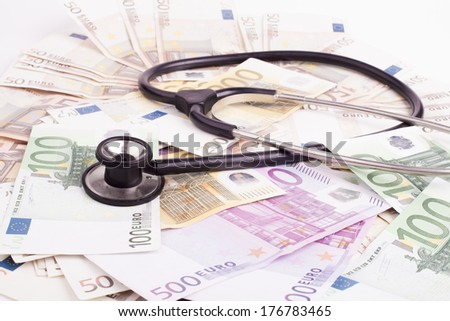 Euro banknotes with black stethoscope close-up  - stock photo