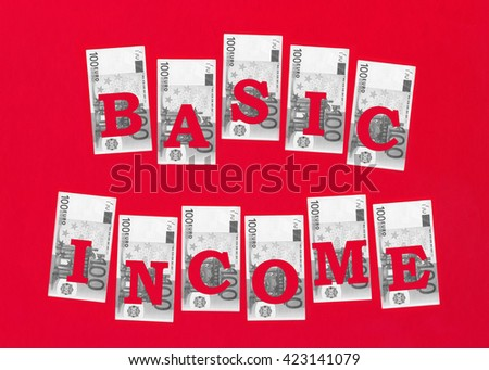 Euro banknotes with cutted out text Basic Income on red background.  - stock photo