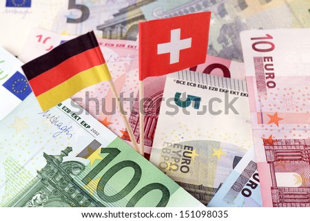 euro banknotes with germany flag and swiss flag / tax evasion