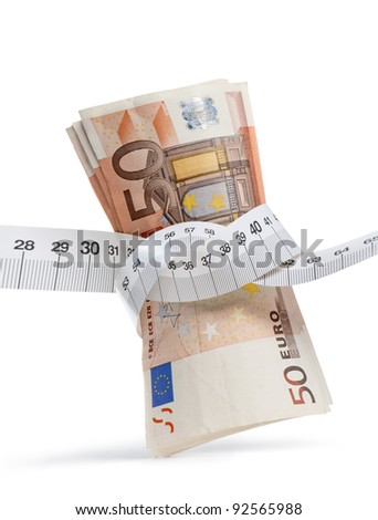 euro banknotes with measure tape on white background, vertical image - stock photo