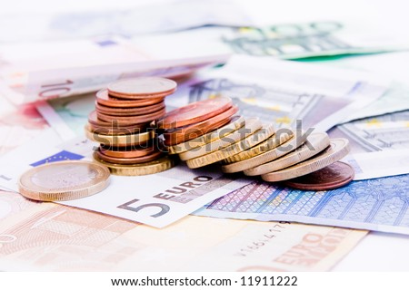 Euro banknotes with various coins - stock photo