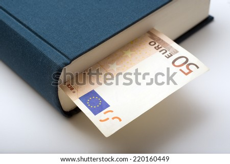 euro bill in a blue book
