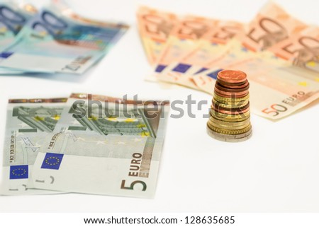 euro bills and coins on white background