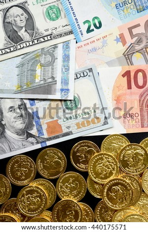 Euro bills and dollar bills with gold coins for background