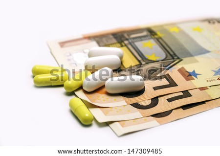 euro bills and pills on white background - stock photo
