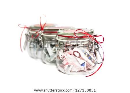 Euro bills in a jar - optional - stock photo