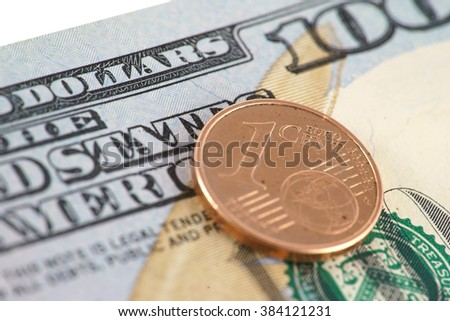 euro cent on the hundred dollar bill - stock photo