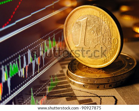 Euro coin and stock graph on a screen. - stock photo