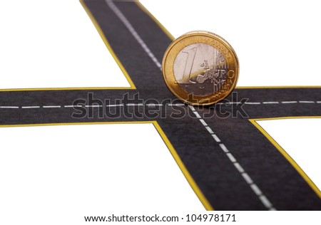 euro coin at the crossroads - stock photo