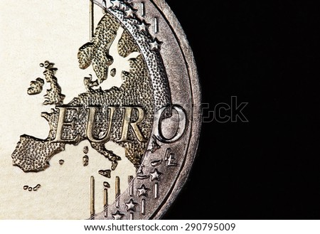 Euro coin on a black background - stock photo