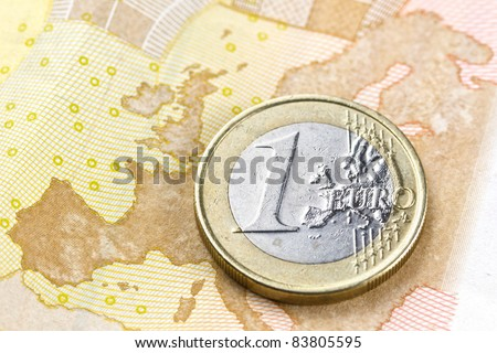 Euro coin on euro map composition from euro banknote revers - stock photo