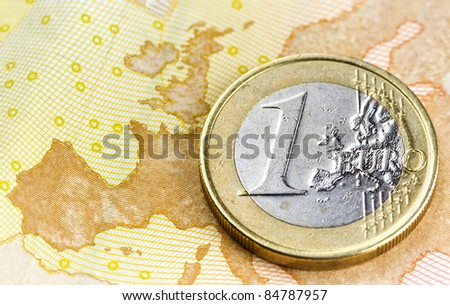 Euro coin on euro map from banknote revers - stock photo