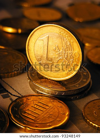 Euro coin on stock chart. Selective focus.