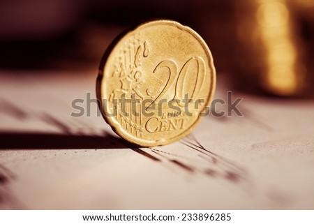 Euro coin on stock chart. Selective focus. Macro image. - stock photo