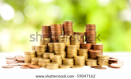 euro coins against plants background - stock photo