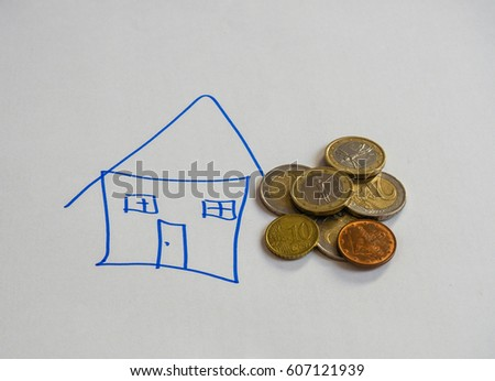 Euro coins and a drawing of a house on white background.