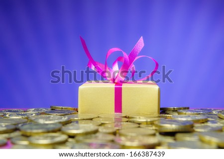 Euro coins and a gift box - stock photo