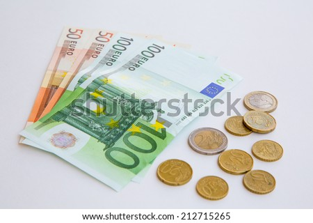 Euro coins and banknotes - stock photo