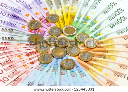 euro coins and banknotes. money background - stock photo