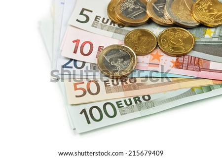 Euro coins and banknotes on white background - stock photo