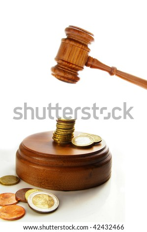 Euro coins and court gavel on white - stock photo