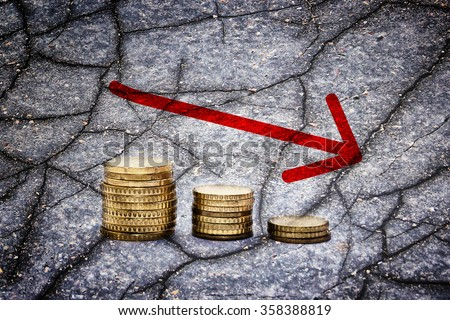 Euro coins and cracks - Finance concept - stock photo
