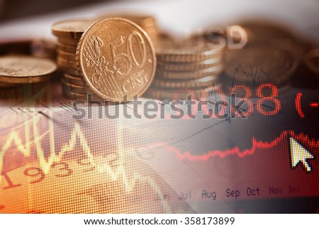 Euro coins and finance data. Finance concept. - stock photo