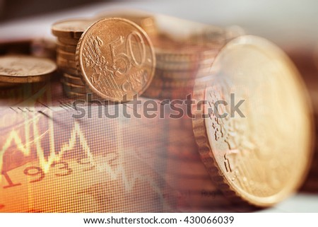 Euro coins and finance data. Finance concept.