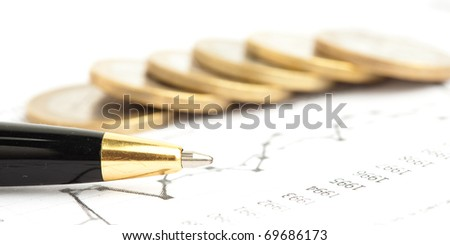 euro coins and pen - stock photo