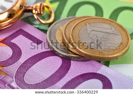 Euro coins, banknotes and pocket watch, close up - stock photo