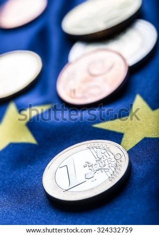 Euro coins. Euro currency. Euro money. European flag and euro money. Coins and banknotes European currency freely laid on the European flag - stock photo